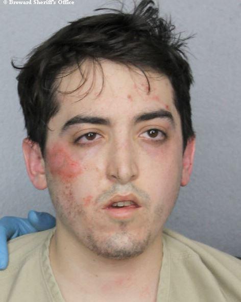 Американец ограбил банк пальцем, азатем голый пробежался поулице